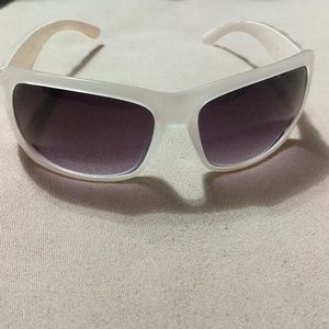 Opaque white sunglasses with diamond side pieces